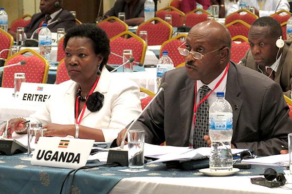 The Attorney General, Hon. Freddie Ruhindi (R) addressing the commission