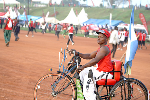A disabled man in his bicycle during the Kabaka's birthday run 2015 that took place at Lubiri on 12th April; 2015.