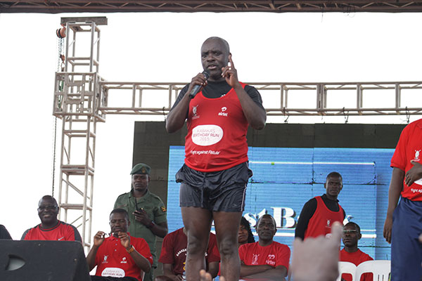 Robert Kabushenga giving a speech after the race during the Kabaka's Birthday run 2015 on 12th April 2015.