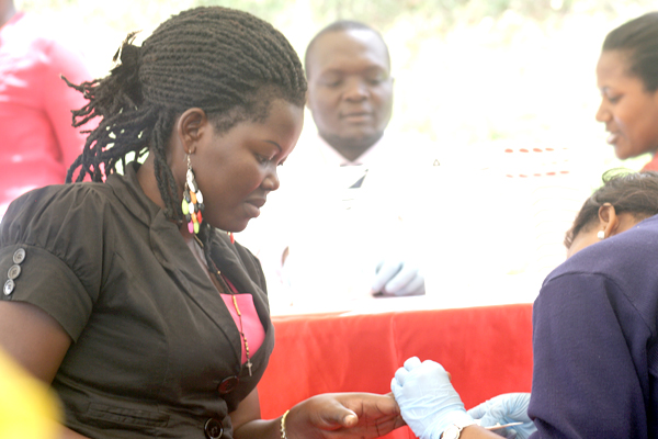 A woman takes a blood test. Vaccines are a great way to prevent many serious infections