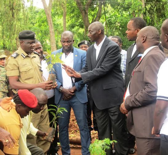 General Aronda Nyakayirima, planting a tree