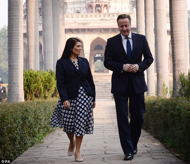 Ms Patel pictured with Prime Minister David Cameron in front of the Shah Sayyid Tomb in the Lodi Gardens in Delhi, India in November 2013. Mr Cameron has re-shuffled his Cabinet in a bid to shed his out of touch image