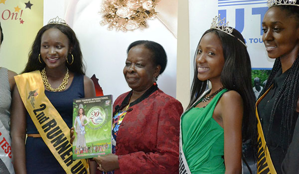 Miss Tourism beauty pageant, 2015 pose for a photo with Tourism minister Maria Mutagamba