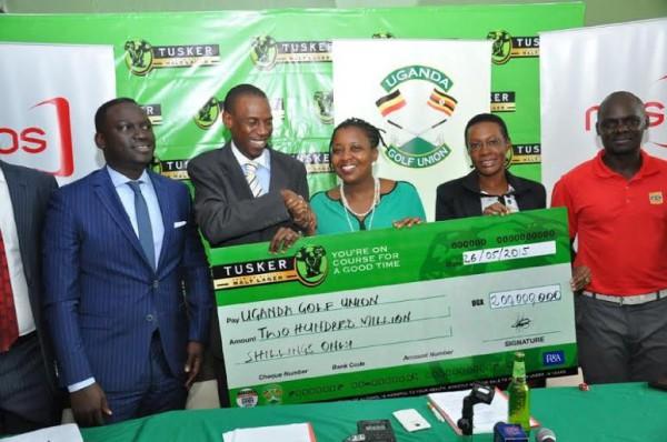 Grace Nsehemeire Gwaku, the Uganda Breweries Marketing Director hands dummy check for the sponsorship 2015 tusker malta Uganda open