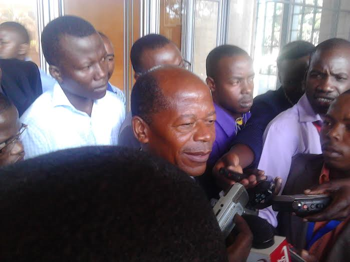 Minister Muyingo talking to journalists after the meeting