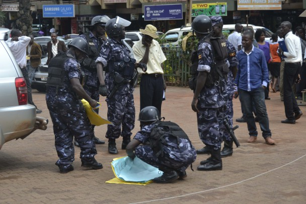 Anti Riot Police collecting pluck cards held by rioters