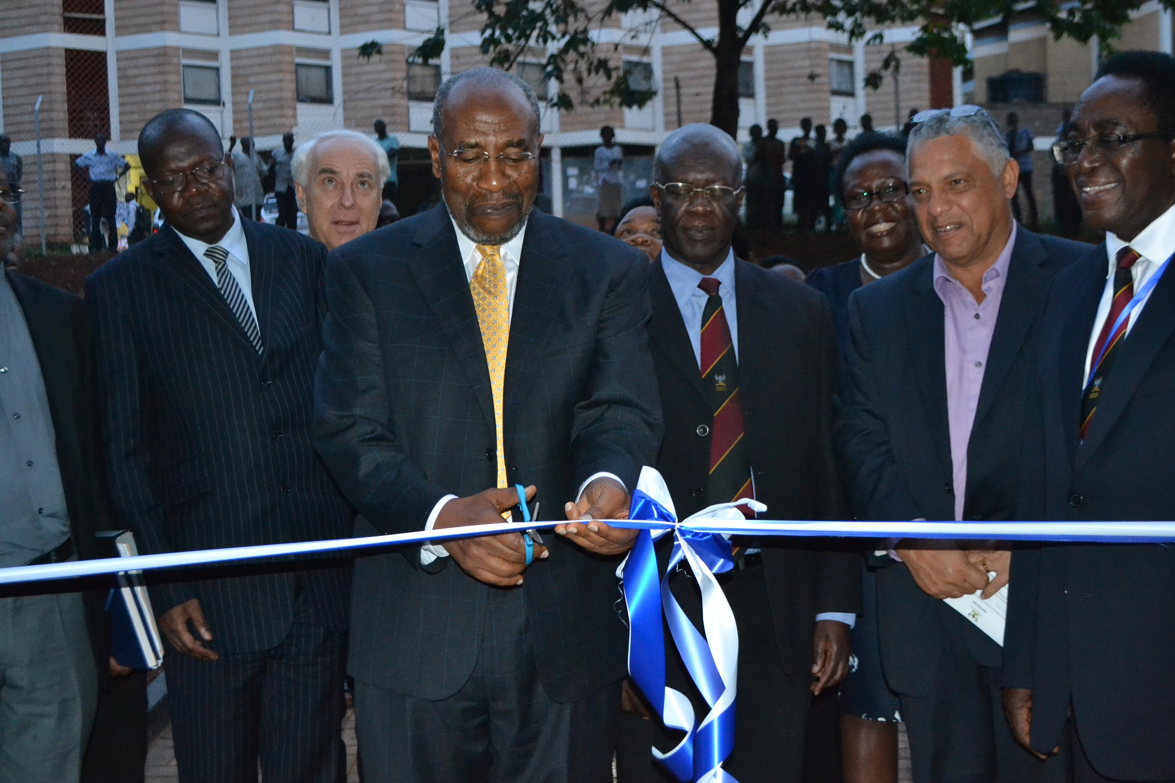 PM Dr Rugunda cuts tape to officially open the  new IDI  McKinnell knowledge centre as MUK officials look on at Makerere University  on Friday
