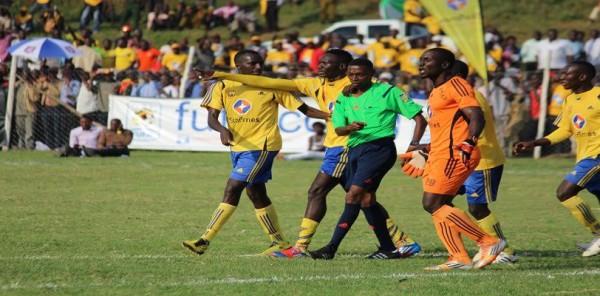KCC players surrounding Referee Donney Robert