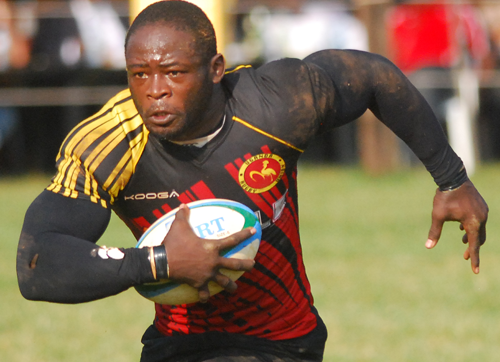 Ruby Cranes Scot Oluoch (with ball) during the Elgon Cup against Kenya