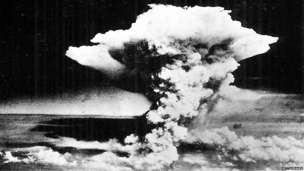 A mushroom cloud over Hiroshima following the explosion of an atomic bomb.
