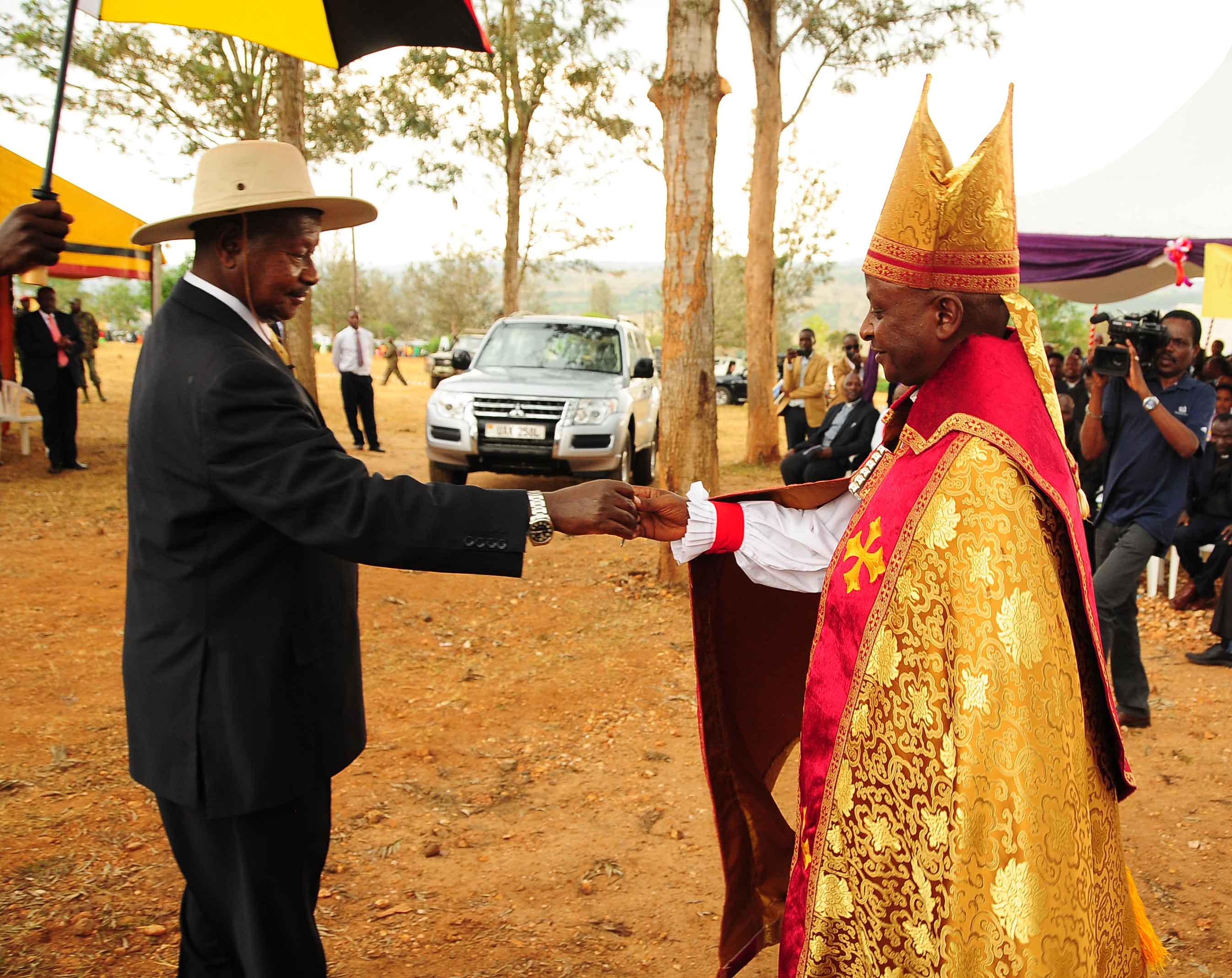 President Yoweri Museveni handing over a key to the brand new Mitsubishi Pajero to the newly concecrated Bishop of West Ankole Diocese, Stephen Namanya during the ceremony at St. Emmanuel Cathedral Rushere. Sunday August 1st 2015.