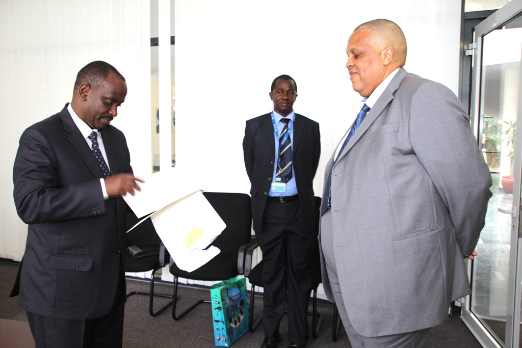 East African Community Secretary General Amb. Dr Richard Sezibera receives credentials from the South African High Commissioner to Tanzania and the East African Community, Amb. Thamsanqa Mseleku (right), at the EAC Headquarters in Arusha, Tanzania.