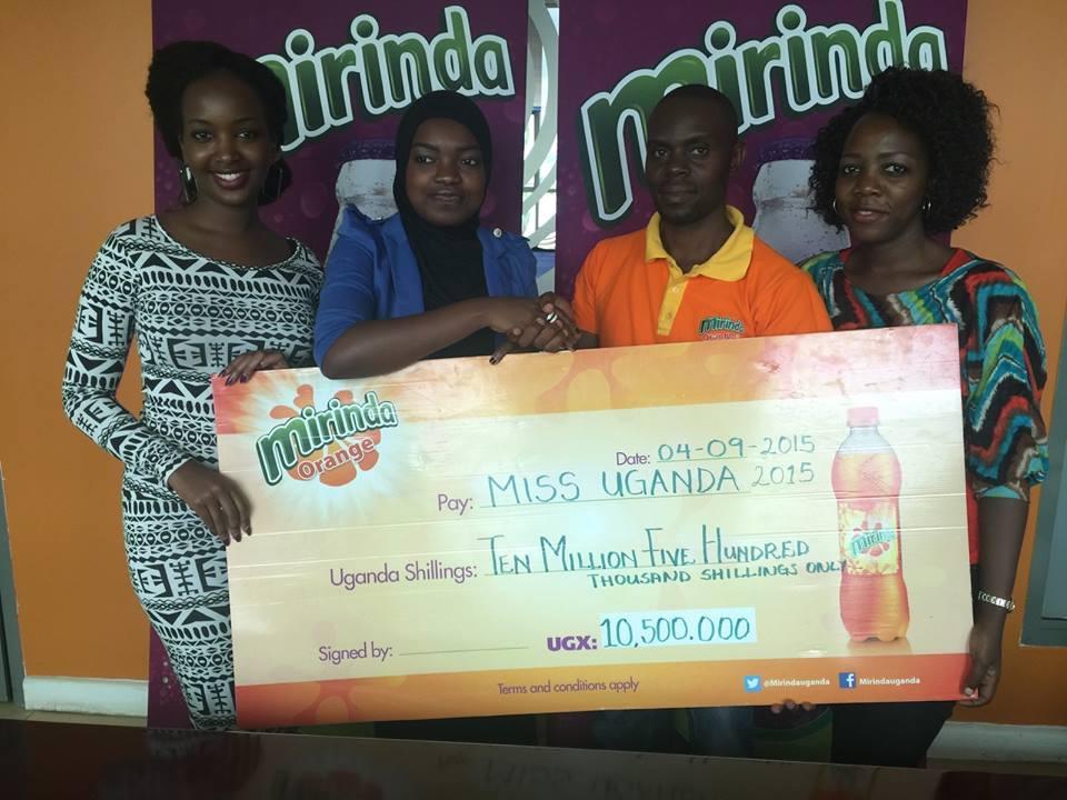 Mirinda brand executive Tracy Kakuru, Miss Uganda Zahara Nakiyaga, Crown Beverages Limited's Customer Marketing Manager Jeff Sekandi and Miss Uganda Foundation's Brenda Nanyonjo.