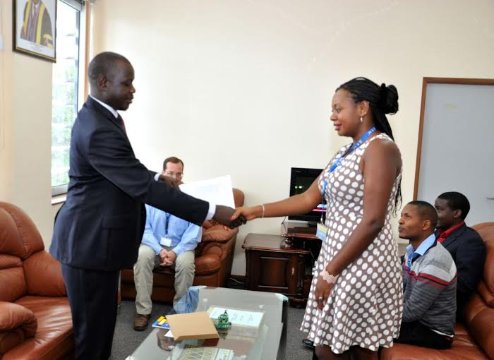 The Speaker receives the petition from Pan-African Lawyers Union (PALU) Programme Officer, Evelyne Chijarira as other Officials look on.